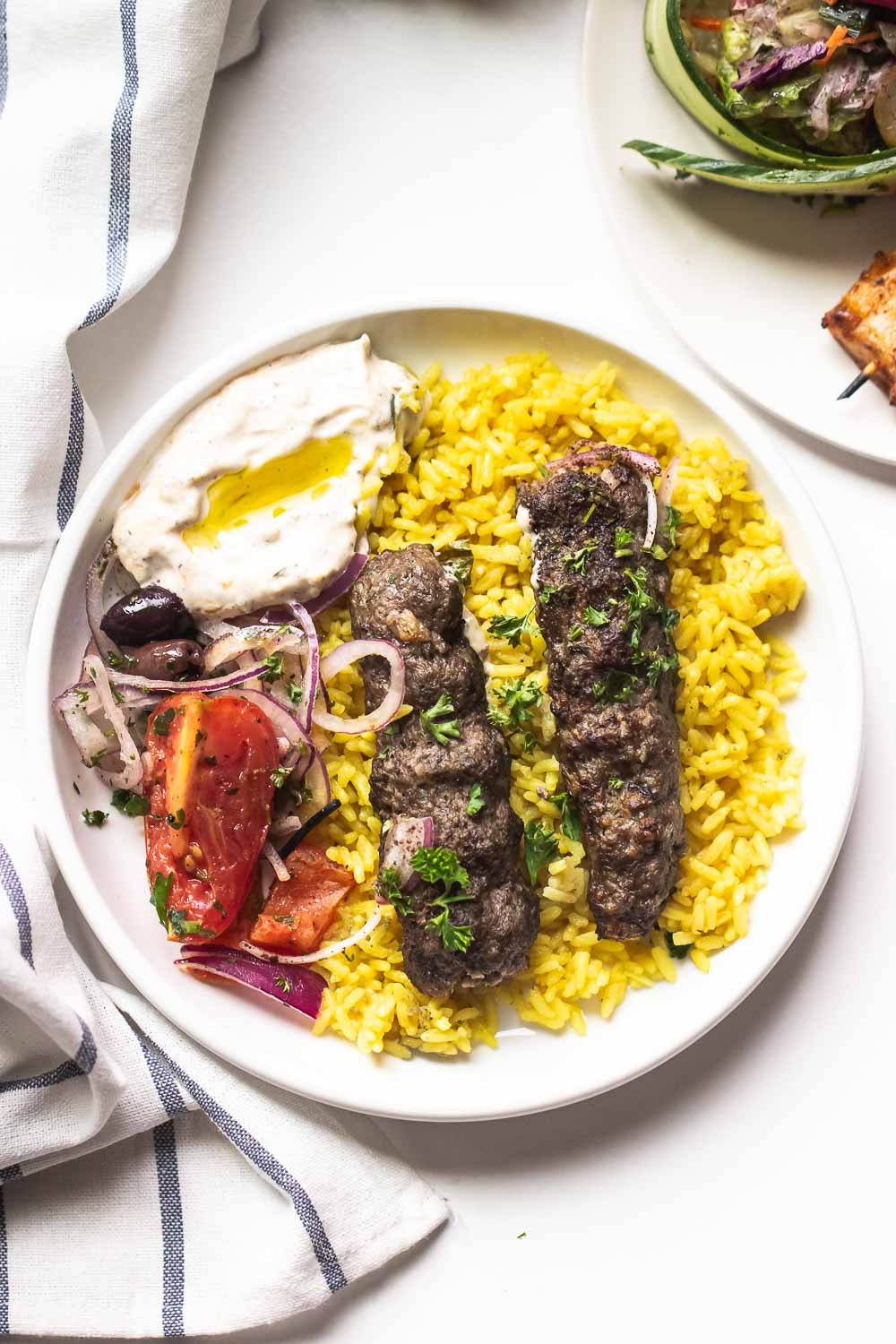Fancy something different tonight? Try these budget-friendly, Middle Eastern-inspired lamb skewers that are easy to make and tasty. One grill, super fast to make, and full of smoky flavors.