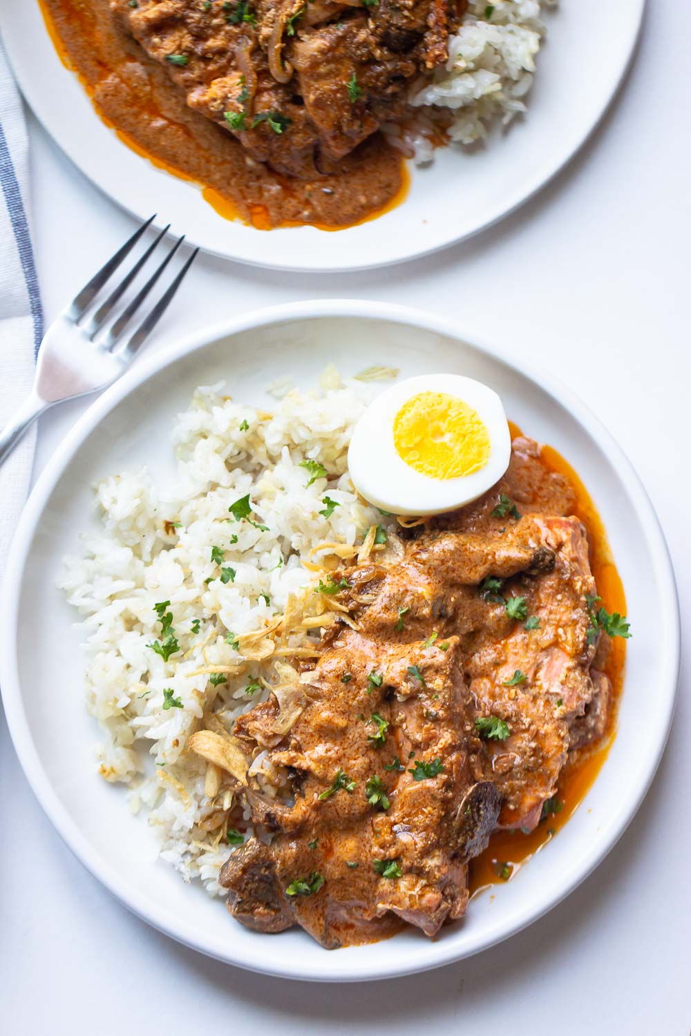 This Salmon Tikka Masala is a flavor-packed, restaurant-quality dish that you can have ready in no time! Serve it over basmati rice, garlic rice, or enjoy with naan for a delicious dinner. Why go out when you can make it better at home!?