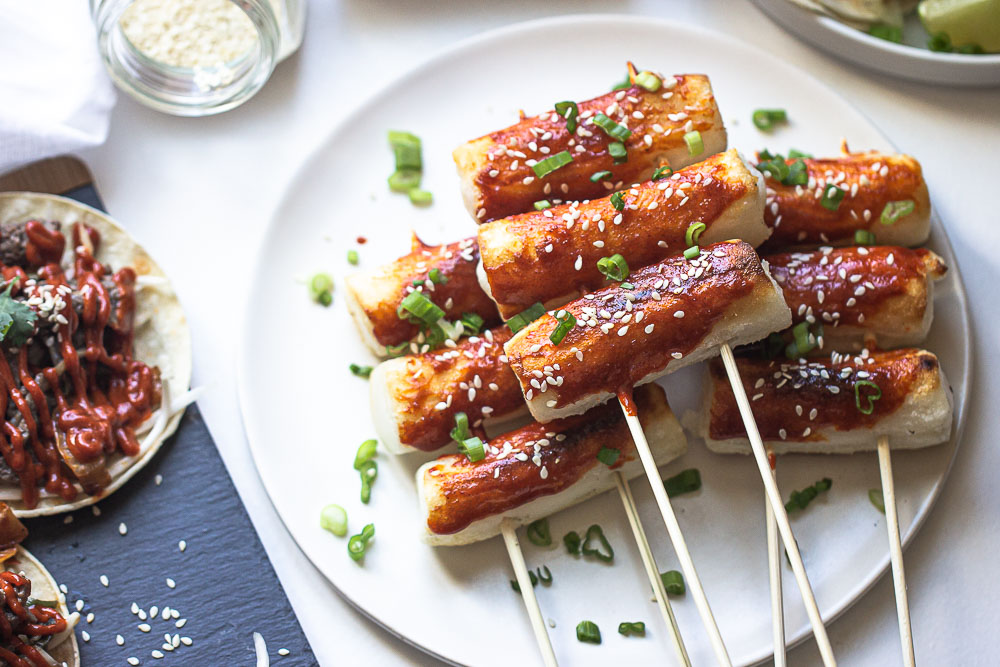 This grilled tteokbokki is a popular Korean street food that comes in the form of a sweet and chewy rice cake. A delicious Asian sauce soaks these rice cakes (or more appropriately, rolls) once they've been grilled to perfection. These spicy, Korean rice cakes are usually about the size of a thumb and have the perfect light crisp on the outside with a delightfully chewy center.