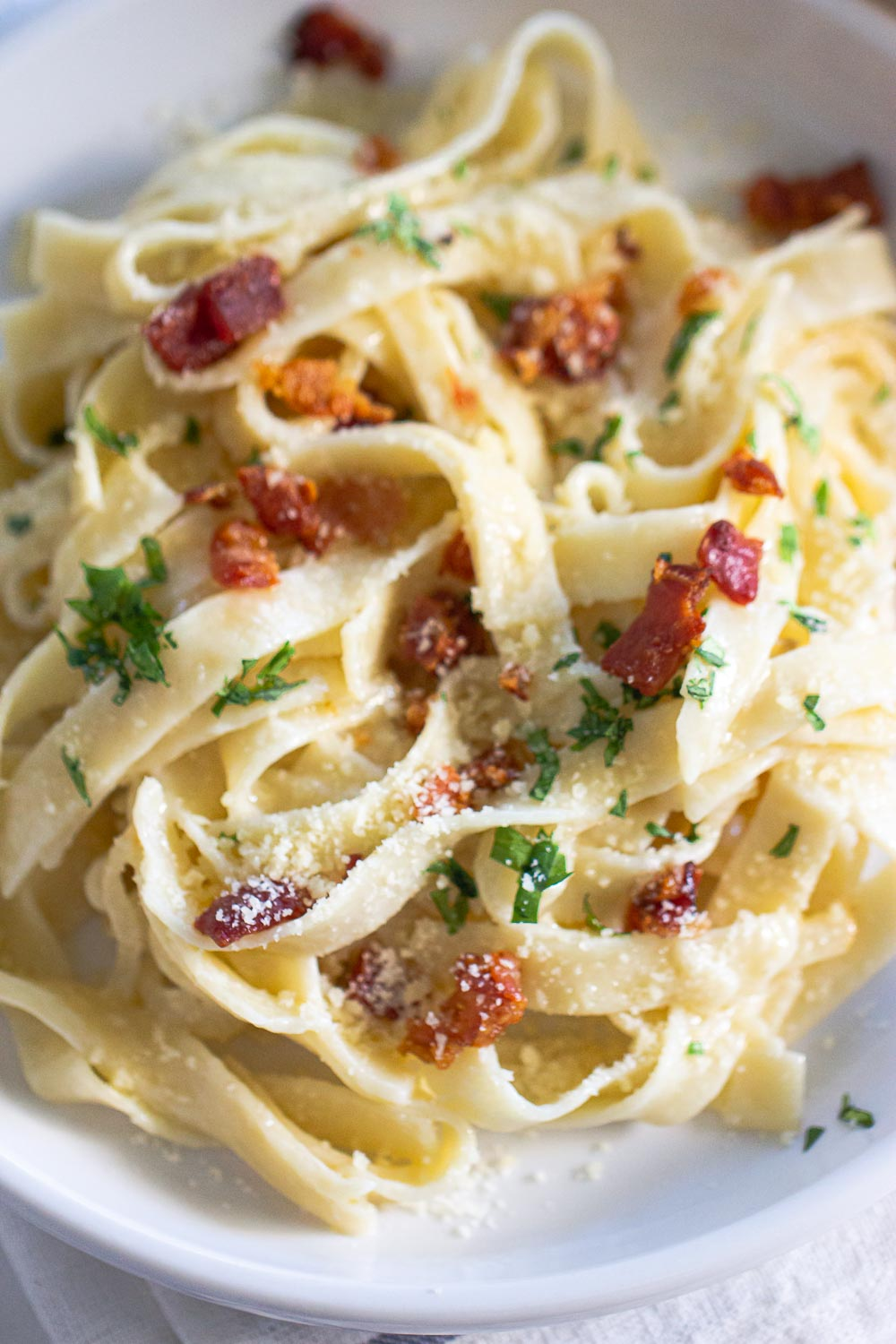This creamy pear and mascarpone pasta get its kick from pear tossed in mascarpone cheese and crispy prosciutto. Ready on the table in 15 minutes and it's perfect for a quick weeknight recipe.