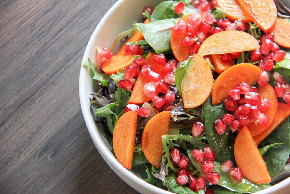 Persimmon Pomegranate Salad. A delicious Fall-inspired salad with all the vibrant and colorful parts of the season combined into one tasty salad.