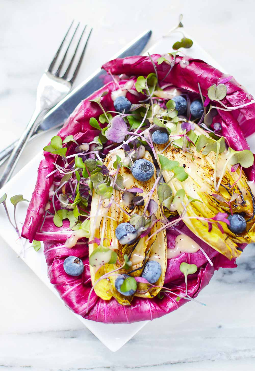 This Radicchio and Endive Salad with Fresh Berries balances bitter flavors with sweetness from berries. So fresh, refreshing, and colorful! Enjoy with a lean protein for a healthy meal.