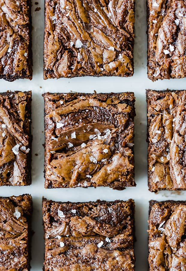 Nutella Brownies that do NOT disappoint! These Nutella Brownies are packed with Nutella and melty chocolate chips, providing each bite with complete satisfaction. These brownies will easily become your new favorite dessert!