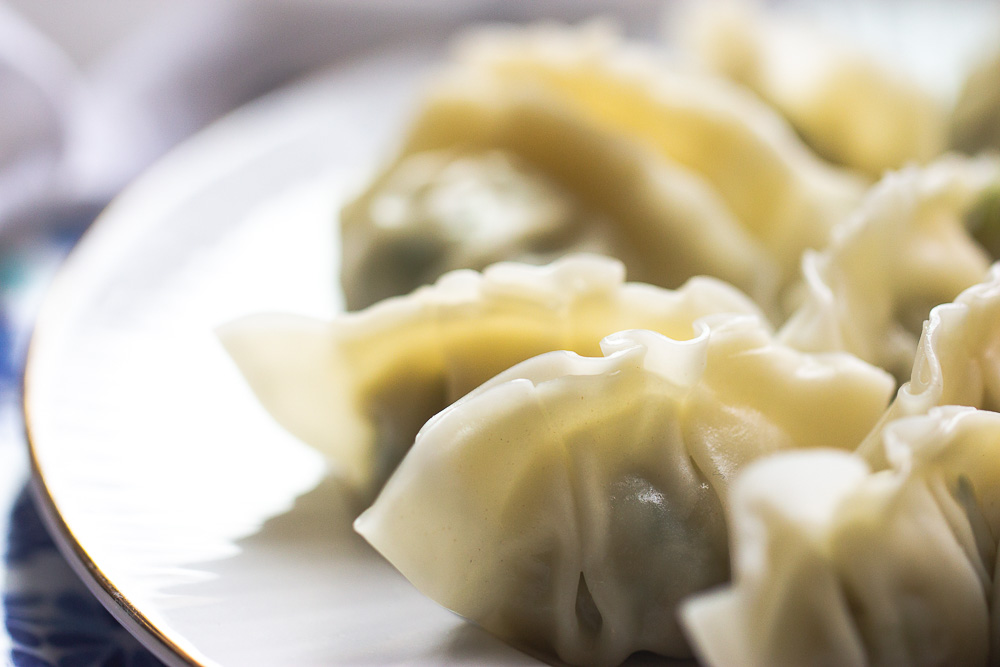 Homemade pork and cabbage potstickers (guotie, jiaozi) are more fun and you will never buy take out again after seeing the video on how these are made.