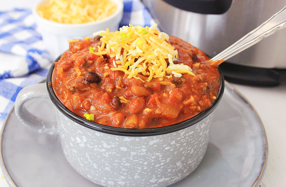 Three Bean Chili is a delicious weeknight meal and awesome as leftovers. Made in an Instant Pot in less than 30 minutes, this chili is hearty, full of flavor, and easy to make.