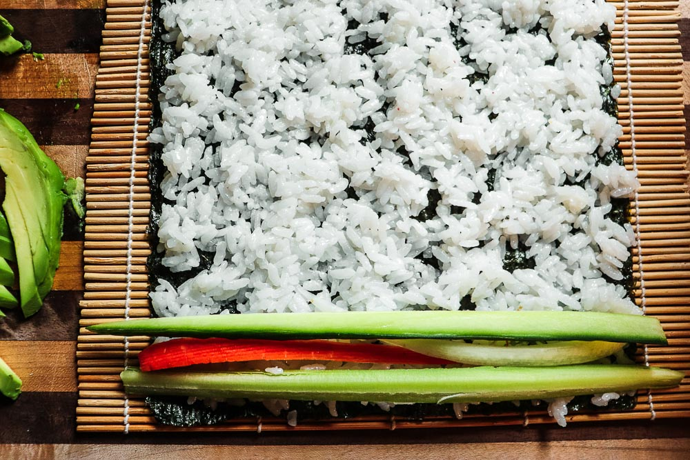This easy vegan sushi recipe is the perfect recipe for a date night in! It's easy, delicious, and can be made so many different fillings.