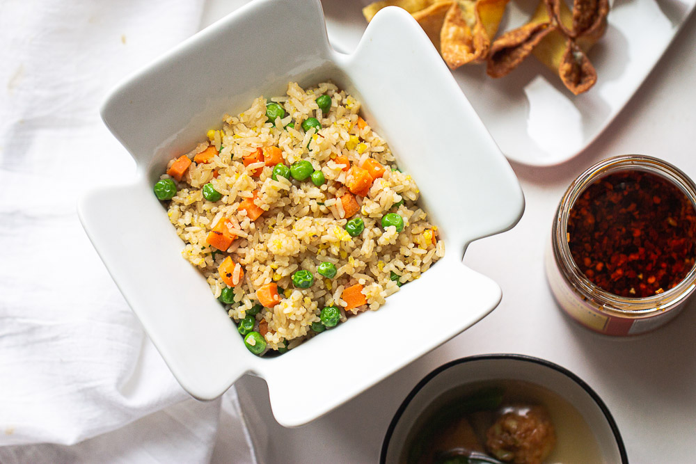 This easy yang chow fried rice (Yangzhou Fried Rice) recipe is the BEST. It's quick and easy to make, customizable with any of your favorite mix-ins, and so irresistibly delicious.