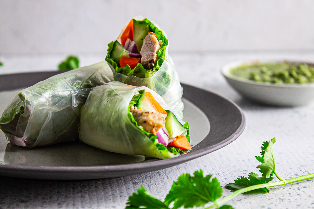 Homemade Chicken Spring Rolls with Cilantro Sauce is easy to make, refreshing, and make a delicious lunch, dinner, or snack on-the-go.