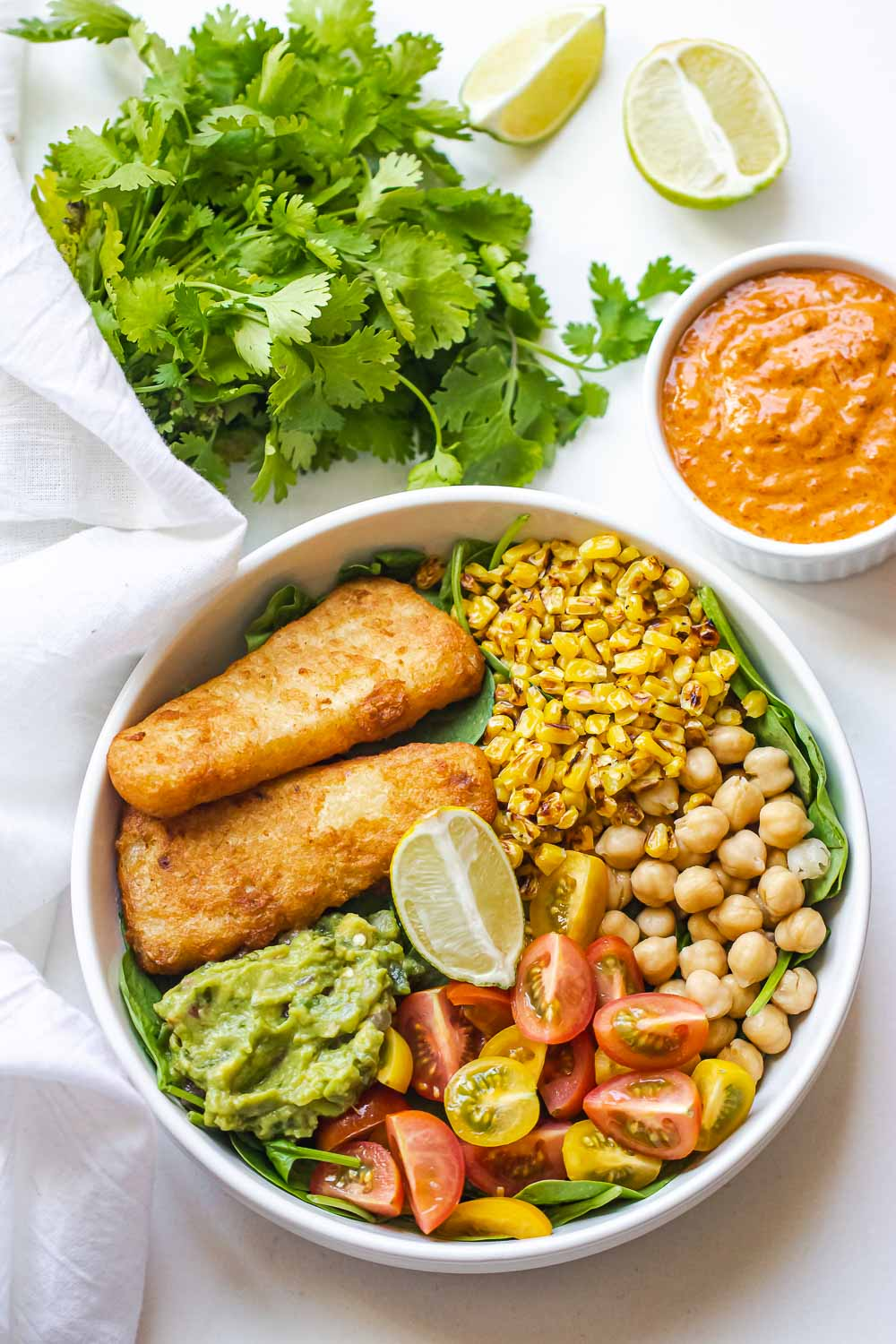 Quickly make this colorful and filling homemade Chipotle Fish Bowl. It's completely flavorful, can be ready in under 30 minutes, and better than you favorite chipotle bowl.